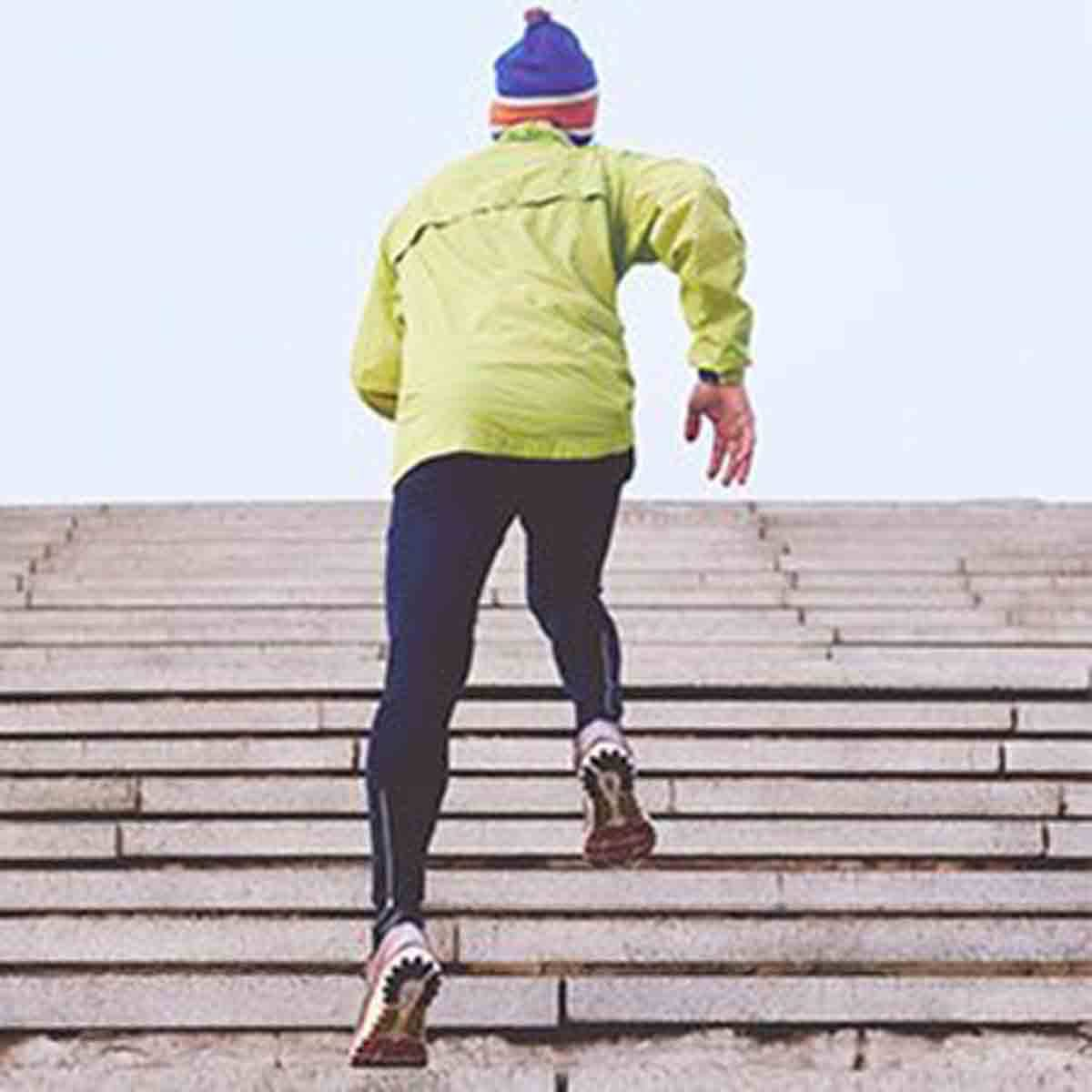 man running stairs, build muscle